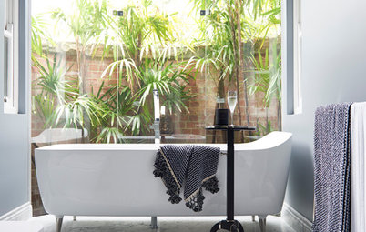 Room of the Week: A Luxe Guest Bathroom With a Raised Bath