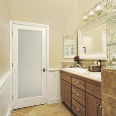 Modern Bathroom by HomeStory Easy Door Installation