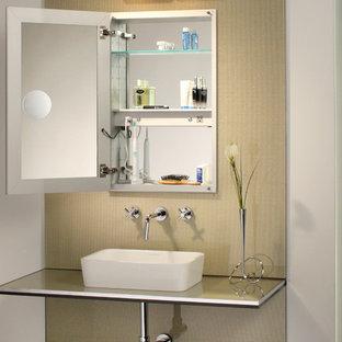 Ispirazione per un'ampia stanza da bagno padronale contemporanea con lavabo a bacinella, ante di vetro, top in vetro, piastrelle multicolore e pareti multicolore