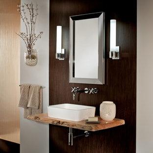 Foto di una stanza da bagno design di medie dimensioni con lavabo a bacinella, ante di vetro, top in legno e pareti multicolore