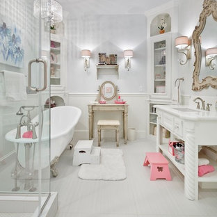 Inspiration for a mid-sized victorian kids' white tile and porcelain tile porcelain floor claw-foot bathtub remodel in Houston with an undermount sink, furniture-like cabinets, white cabinets, granite countertops and white walls