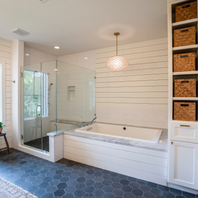 Example of a large transitional master white tile and subway tile porcelain tile, gray floor, double-sink and shiplap wall bathroom design in Houston with furniture-like cabinets, medium tone wood cabinets, an undermount tub, a one-piece toilet, white walls, an undermount sink, marble countertops, a hinged shower door, gray countertops and a freestanding vanity