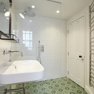 Inspiration for a small classic bathroom in London with a wall mounted toilet, white tiles, metro tiles, a wall-mounted sink, marble worktops, an open shower, white worktops, ceramic flooring and multi-coloured floors.