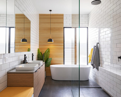 inspiration for a mid sized contemporary master bathroom in adelaide with flat panel cabinets