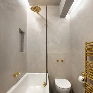 Foto di una piccola stanza da bagno minimal con ante lisce