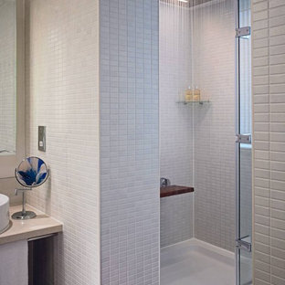 Example of a minimalist gray tile alcove shower design in London