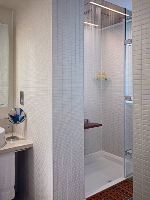 example of a minimalist bathroom design in london with an alcove shower and gray tile