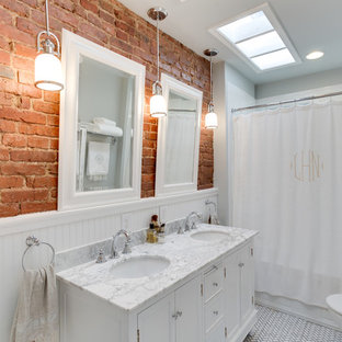 Inspiration for a traditional bathroom in DC Metro with an undermount sink, recessed-panel cabinets, white cabinets, an alcove tub, a shower/bathtub combo and white tile.