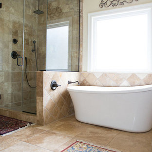 Inspiration for a medium sized mediterranean ensuite bathroom in Other with travertine flooring, brown tiles, brown walls, a freestanding bath, a corner shower, stone tiles, brown floors and a hinged door.