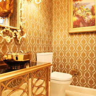 Imagen de cuarto de baño de estilo americano, pequeño, con lavabo encastrado, armarios tipo mueble, puertas de armario amarillas, encimera de mármol, sanitario de pared, baldosas y/o azulejos de porcelana, paredes multicolor, suelo de baldosas de cerámica y baldosas y/o azulejos beige