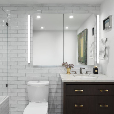 Tub/shower combo - mid-sized contemporary master white tile and ceramic tile marble floor and gray floor tub/shower combo idea in Chicago with flat-panel cabinets, dark wood cabinets, a two-piece toilet, white walls, an undermount sink, quartzite countertops, a hinged shower door and gray countertops