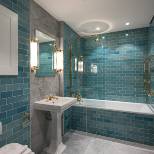 Example of a transitional master blue tile and subway tile bathroom design in London with blue walls and a pedestal sink