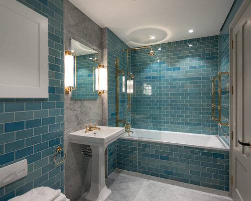 photo of a classic ensuite bathroom in london with a built in bath a
