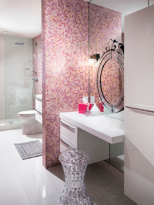large pink tile and mosaic tile bathroom idea in miami with flatpanel cabinets