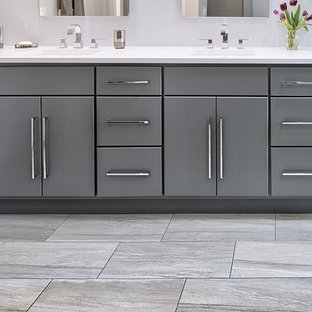 Inspiration for a medium sized modern ensuite bathroom in Chicago with flat-panel cabinets, grey cabinets, a corner shower, a two-piece toilet, grey tiles, ceramic tiles, grey walls, porcelain flooring, a submerged sink and engineered stone worktops.