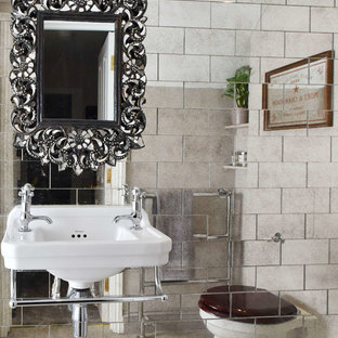 Bohemian bathroom in London with mirror tiles and a wall-mounted sink.