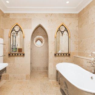 Imagen de cuarto de baño principal, mediterráneo, de tamaño medio, con bañera exenta, lavabo con pedestal, baldosas y/o azulejos beige y suelo beige