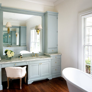 Design ideas for a traditional master bathroom in Atlanta with blue cabinets, granite benchtops, dark hardwood floors, an undermount sink, a claw-foot tub, white walls and recessed-panel cabinets.