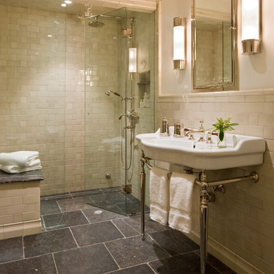 Inspiration for a timeless beige tile and subway tile black floor alcove shower remodel in Denver with a console sink