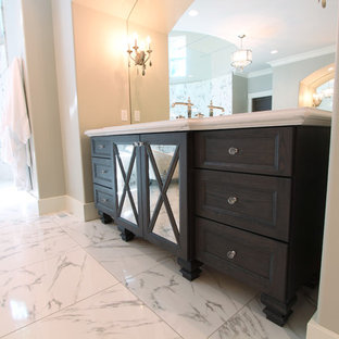 Huge elegant master white tile and porcelain tile porcelain floor bathroom photo in Other with recessed-panel cabinets, gray cabinets, a two-piece toilet, gray walls, an undermount sink and engineered quartz countertops