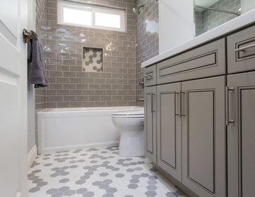 Gray tones playfulness. A kids bathroom in Oak park.