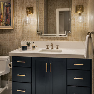 Inspiration for a mid-sized contemporary 3/4 ceramic tile and beige floor bathroom remodel in Phoenix with recessed-panel cabinets, blue cabinets, a one-piece toilet, beige walls, an undermount sink and quartz countertops