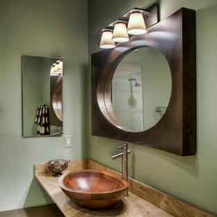 Imagen de cuarto de baño con ducha, asiático, de tamaño medio, con lavabo sobreencimera, armarios abiertos, puertas de armario de madera en tonos medios, encimera de mármol, ducha esquinera, sanitario de una pieza, paredes verdes y suelo de baldosas de cerámica