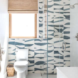 Walk-in shower - contemporary 3/4 blue tile, multicolored tile, white tile and cement tile white floor walk-in shower idea in San Francisco with multicolored walls and a hinged shower door