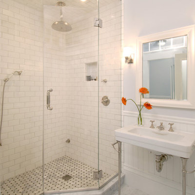 Elegant subway tile marble floor corner shower photo in Boston with a console sink