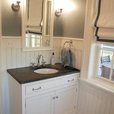 Farmhouse Bathroom by Custom Structures Inc