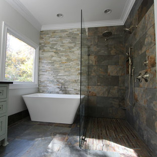 Inspiration for a mid-sized eclectic master bathroom in Atlanta with an undermount sink, flat-panel cabinets, green cabinets, granite benchtops, a freestanding tub, a curbless shower, a two-piece toilet, multi-coloured tile, stone tile, grey walls and slate floors.