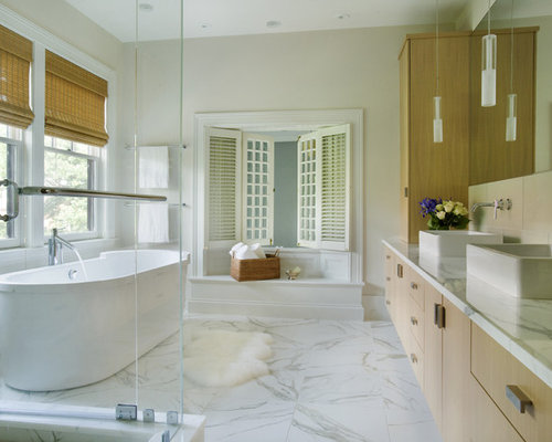 example of a trendy freestanding bathtub design in boston with a vessel sink marble floors