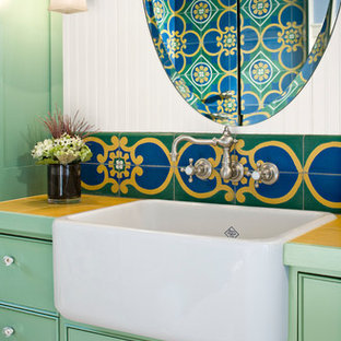 Example of a small eclectic 3/4 multicolored tile and cement tile light wood floor corner shower design in Seattle with green cabinets, tile countertops, a trough sink, a one-piece toilet, white walls, shaker cabinets and a hinged shower door