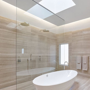 Example of a large minimalist master gray tile and stone slab marble floor bathroom design in San Francisco with an integrated sink, flat-panel cabinets, dark wood cabinets, quartz countertops, a wall-mount toilet and gray walls