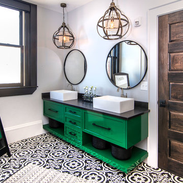 Green vanity with black and white tile floor