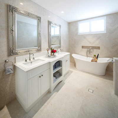 Inspiration for a timeless master beige tile and marble tile marble floor and beige floor freestanding bathtub remodel in Sydney with recessed-panel cabinets, white cabinets, quartz countertops and white countertops