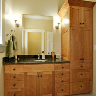 Example of an arts and crafts bathroom design in Seattle with an undermount sink, shaker cabinets and medium tone wood cabinets