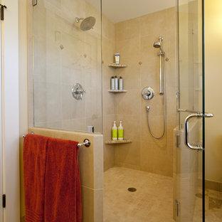 Inspiration for a craftsman beige tile corner shower remodel in Seattle