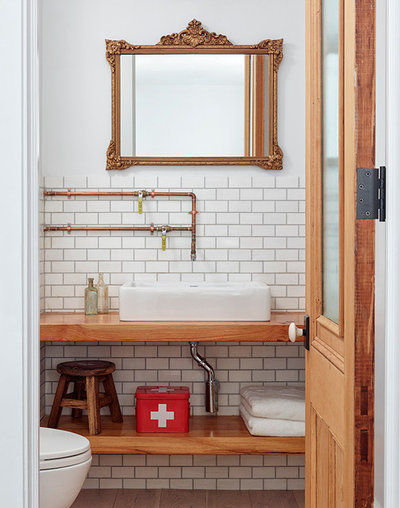 Traditional Bathroom by WE  Design