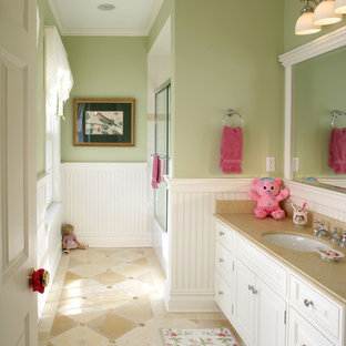 Inspiration for a medium sized traditional family bathroom in New York with a submerged sink, recessed-panel cabinets, white cabinets, beige tiles, green walls and ceramic flooring.
