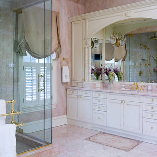 Inspiration for a timeless marble floor and pink floor alcove shower remodel in New York with pink walls