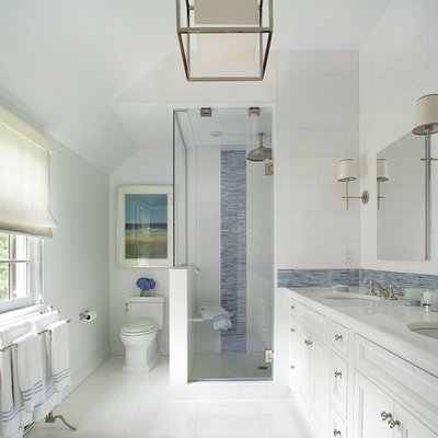 Example of a large transitional master blue tile and matchstick tile ceramic tile alcove shower design in New York with an undermount sink, recessed-panel cabinets, white cabinets, a two-piece toilet, marble countertops, white walls and white countertops