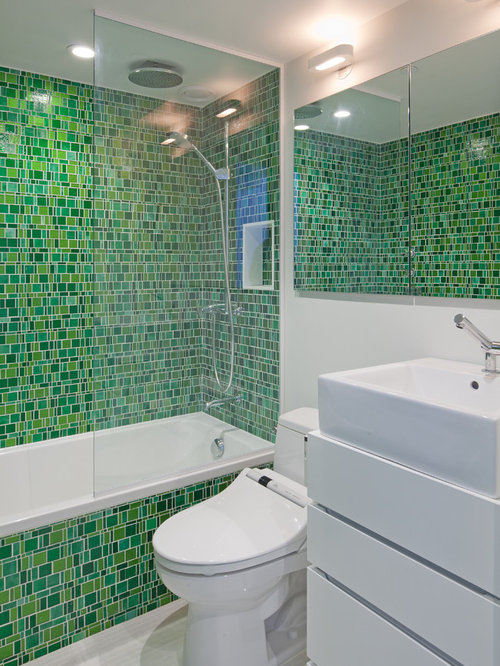Mosaic Bathroom Tile Ideas Inspiration for an eclectic bathroom remodel in New York with mosaic tile, a vessel sink
