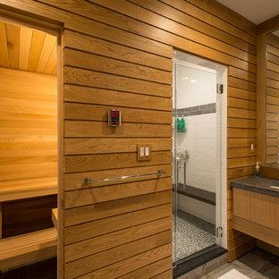 Exempel på ett klassiskt bastu, med släta luckor, skåp i mellenmörkt trä, en dusch i en alkov och ett undermonterad handfat