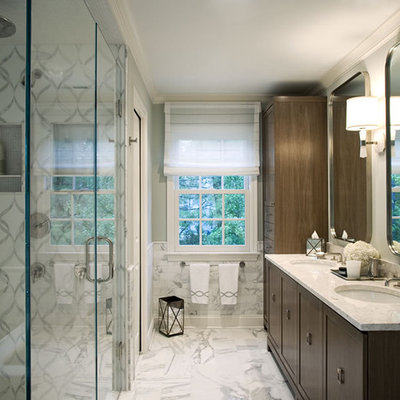 Trendy white tile and marble tile bathroom photo in New York with an undermount sink, shaker cabinets, dark wood cabinets, marble countertops, a two-piece toilet and a hinged shower door