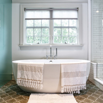 Example of a transitional white tile and subway tile bathroom design in New York