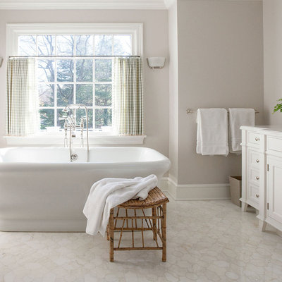 Example of a large classic master white tile and stone slab terra-cotta tile and white floor bathroom design in New York with an undermount sink, recessed-panel cabinets, white cabinets, gray walls, a one-piece toilet, solid surface countertops and white countertops