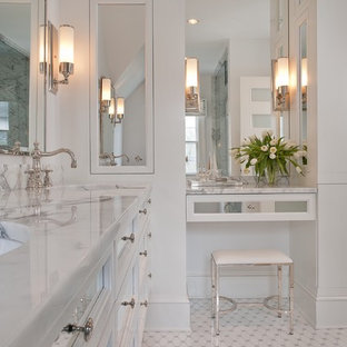 Inspiration for a large timeless master white tile and glass tile ceramic floor and white floor bathroom remodel in New York with marble countertops, furniture-like cabinets, white cabinets, white walls, an undermount sink and white countertops
