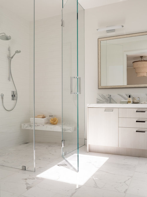 trendy white tile corner shower photo in san francisco with flatpanel cabinets