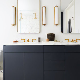 Bathroom - scandinavian master multicolored floor bathroom idea in New York with furniture-like cabinets, black cabinets, white walls and white countertops